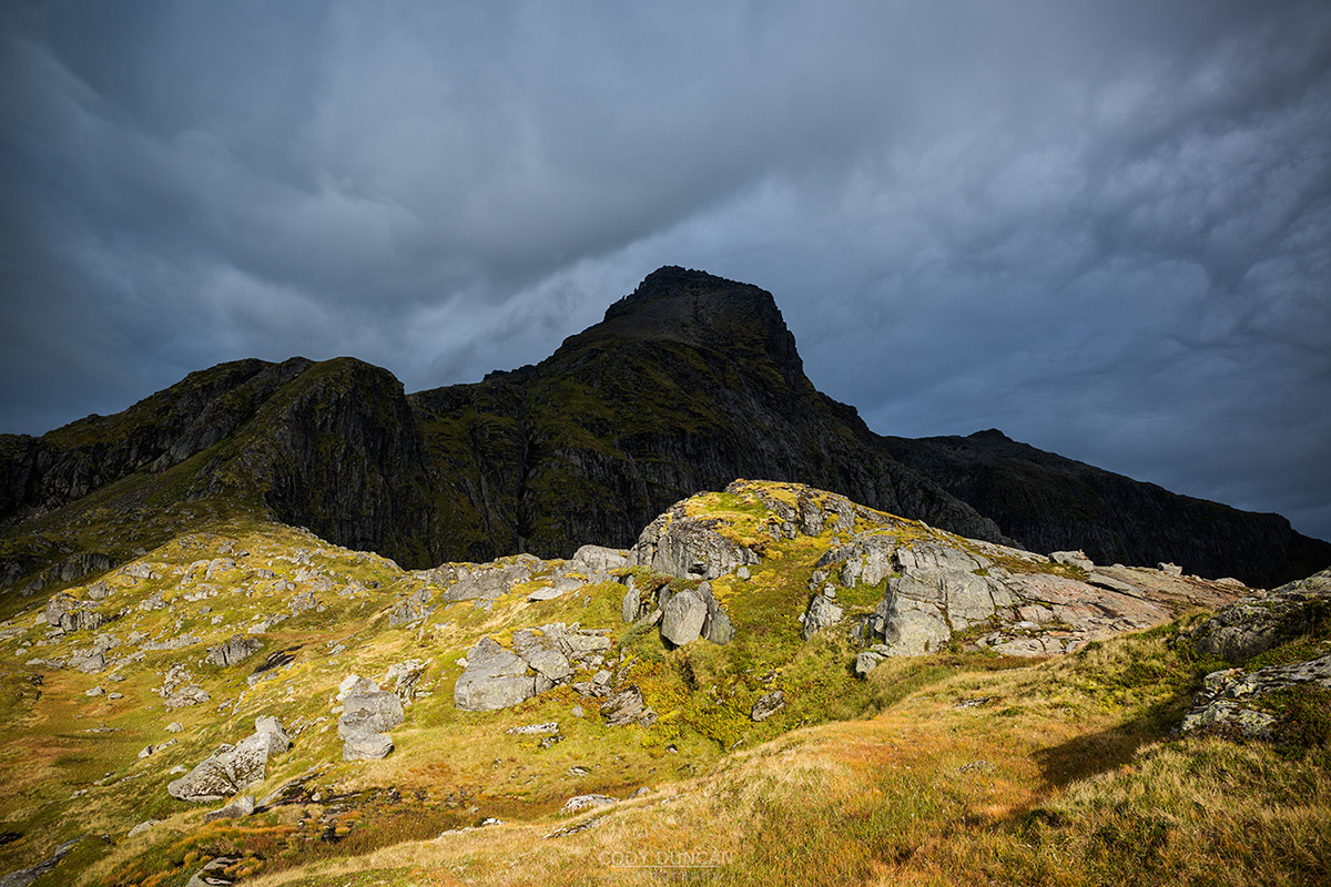 Dramatic clouds over summit of Hermannsdalstinden, Moskenesoy, Lofoten Islands, Norway